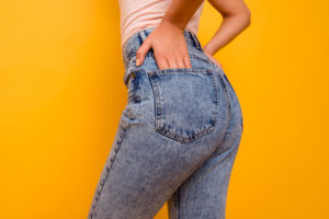 Cropped close-up of woman's buttocks in jeans