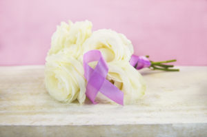 Pink breast cancer awareness ribbon with white roses