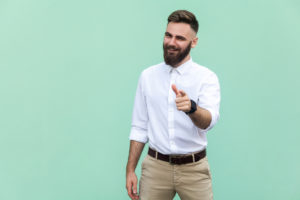 young bearded male winking and pointing at the camera