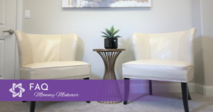 Empty waiting room area with two chairs and end table with a plant