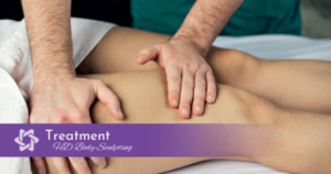 Patient receiving lymphatic massage on thighs